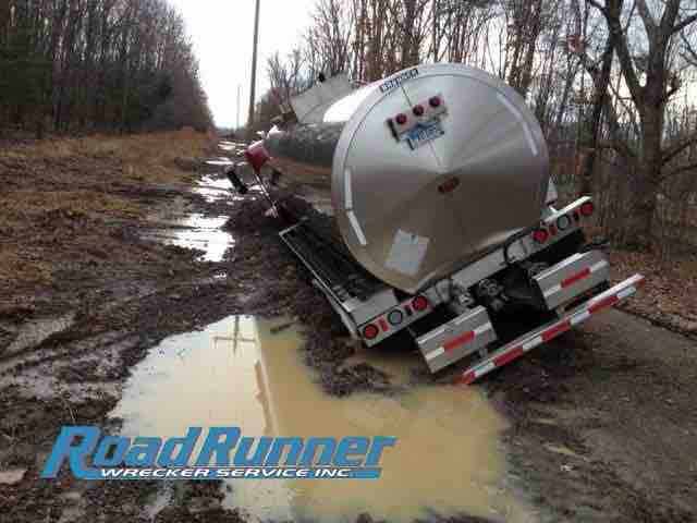 Tank truck leaning on side prior to heavy duty towing