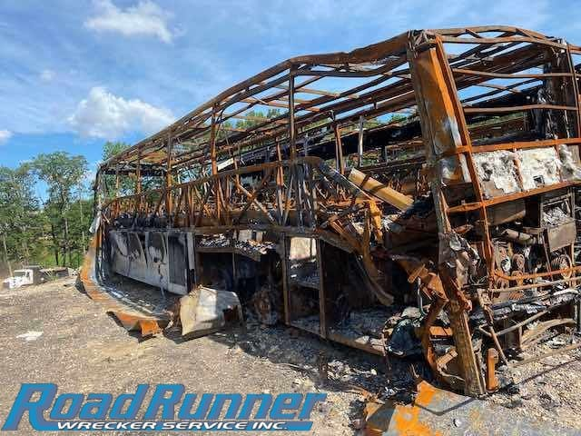 Bus Towing Company Takes on 4 Burnt Buses