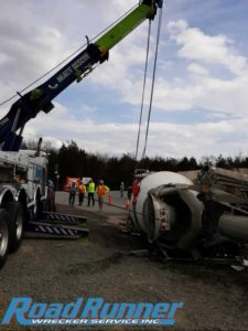 Heavy duty towing rotator provides crane service to lift cement mixer