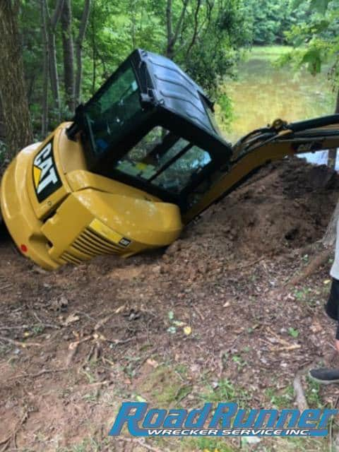 Heavy Towing Operator Expertly Recovers 6000 Pound Mini Excavator