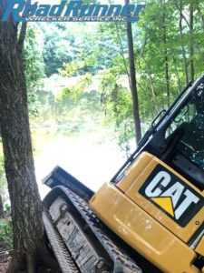 Heavy towing recovery of an excavator